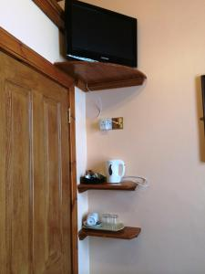 A television and/or entertainment center at Bellevue Guest House