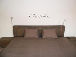 A bed or beds in a room at B&B Caramel
