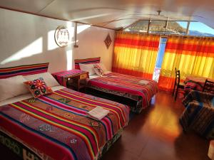 A bed or beds in a room at UROs ARUNTAWI LODGE