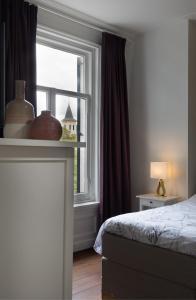 Een bed of bedden in een kamer bij B&B Villa Kriekenbeek