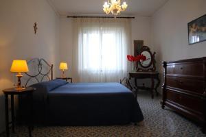 Letto o letti in una camera di La Murena