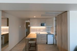 A kitchen or kitchenette at The White Apartments - Adults Only