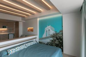 A bed or beds in a room at The White Apartments - Adults Only