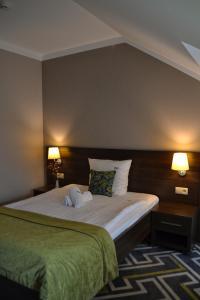 Łóżko lub łóżka w pokoju w obiekcie Hotel & Browar Słociak
