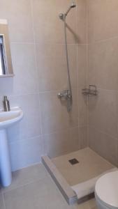 A bathroom at Telhinis Hotel