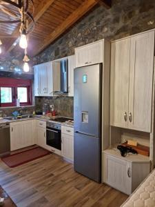 A kitchen or kitchenette at House with big garden and barbeque in nature
