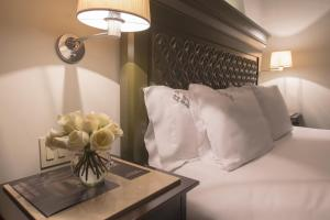 A bed or beds in a room at Casa Grande Hotel Boutique