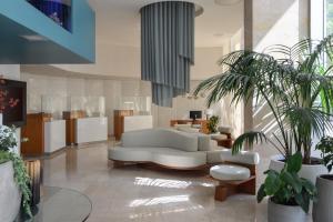 O saguão ou recepção de Melia Lisboa Oriente Hotel