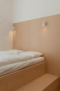 A bed or beds in a room at Flow Spaces