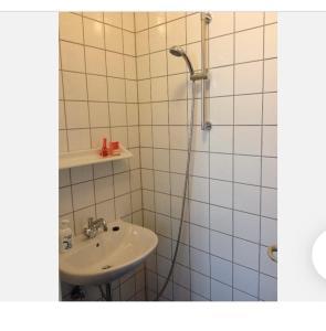 A bathroom at Sundbyvestervarehus