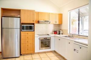 A kitchen or kitchenette at Presidential Bungalow