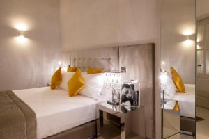 A bed or beds in a room at Palazzo Nainer