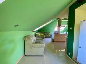Posedenie v ubytovaní Apartmán podkrovie Nedožery Brezany
