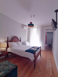 A bed or beds in a room at Allgo Hostel