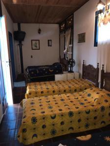 A bed or beds in a room at Pousada Gota de Minas