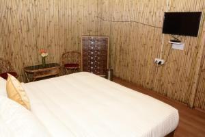 A bed or beds in a room at Naro Eco Resort and Spa