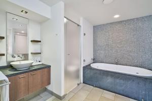 A bathroom at On The Beach 321 - Port Douglas