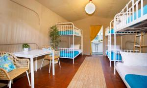A bunk bed or bunk beds in a room at The Beachcamp Eco Retreat
