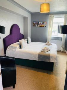 A bed or beds in a room at The Traxx Hotel