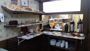 A kitchen or kitchenette at Hotel Gonçalves- Próximo a Santa Casa de Porto Alegre
