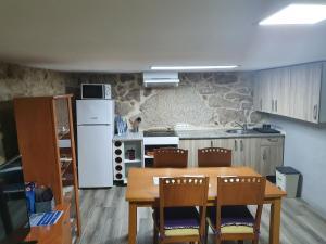 A kitchen or kitchenette at Aldea cristimil -san amaro