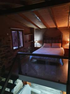 A bed or beds in a room at Aldea cristimil -san amaro