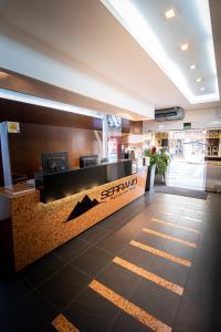 The lobby or reception area at Serrano Residencial Hotel