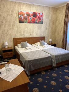 Кровать или кровати в номере Zatyshok
