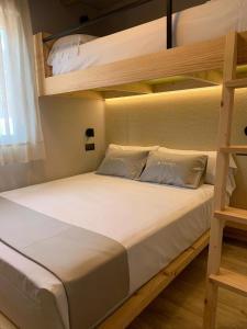 Cama o camas de una habitación en La Marina Resort