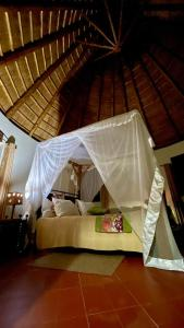 A bed or beds in a room at Kibale Guest Cottages
