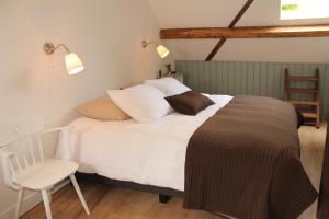 Een bed of bedden in een kamer bij Bed & Breakfast Langlaar