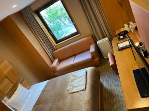 A seating area at HOTEL RELIEF Sapporo Susukino