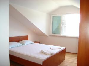 A bed or beds in a room at Apartments & Rooms Villa Lucija