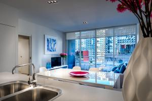 A kitchen or kitchenette at Milano Serviced Apartments