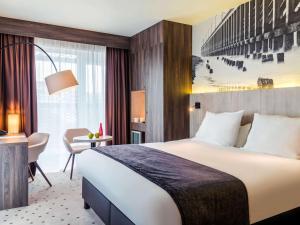 Un ou plusieurs lits dans un hébergement de l'établissement Hotel Mercure Blankenberge Station