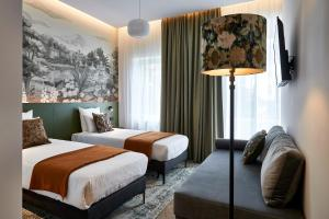A bed or beds in a room at Urban Yard Hotel