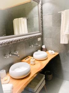 Ein Badezimmer in der Unterkunft Isabelle's Rosegarden
