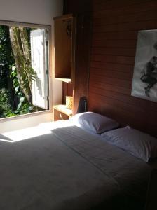 A bed or beds in a room at Pousada Casa Grande