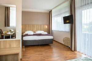 A bed or beds in a room at Hotel Rhön Residence