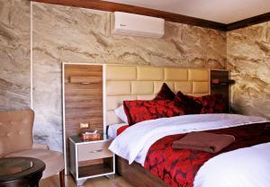 Un ou plusieurs lits dans un hébergement de l'établissement Seven Wonders Luxury Camp
