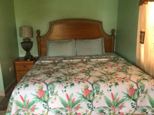 A bed or beds in a room at Antigua Seaview