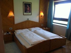 Cama o camas de una habitación en Piccolo Hotel Sciliar