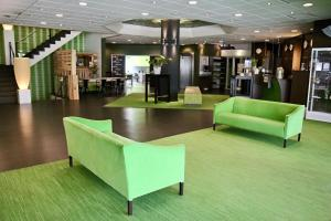 The lobby or reception area at Best Western Plus Rotterdam Airport Hotel
