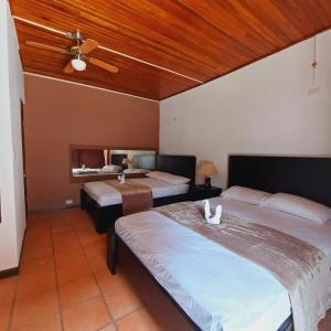 A bed or beds in a room at Uruka Lodge