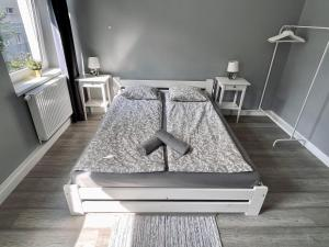 A bed or beds in a room at Apartament w Sopocie - Kazimierza