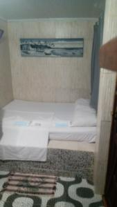 A bed or beds in a room at Espaço das Estrelas Praia do Forte