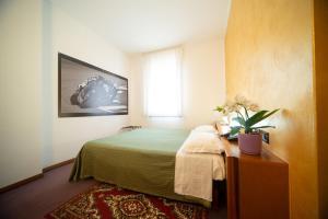 Letto o letti in una camera di Hotel Cima