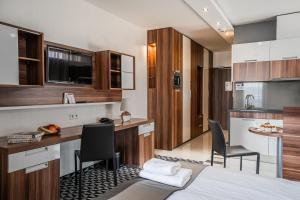Kuchyňa alebo kuchynka v ubytovaní Aparthotel Vanilla