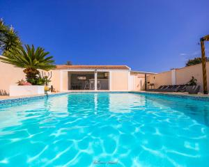 The swimming pool at or near Résidence Mari & Villa Lisa-Maria