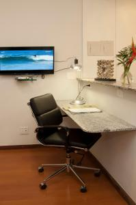 A television and/or entertainment center at Max Savassi Apart Service